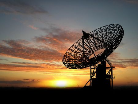 satellite tv: Three satelite dishes over sunset