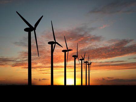 electrics: Wind turbine farm over sunset
