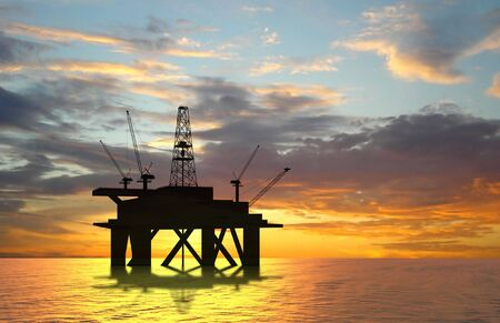 Oil rig silhouette over orange sky Stock Photo