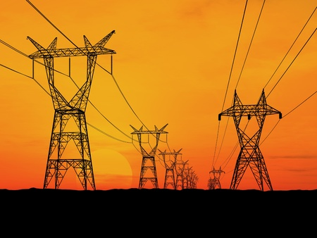 Electricity pylons and lines at dusk. photo
