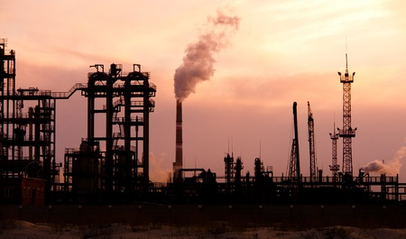 Oil refinery at sunset. Enviroment pollution. photo