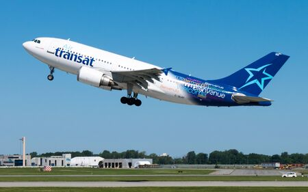 Montreal Quebec, Canada -July 30, 2017: An Air Transat Jet Airplane taking off from Pierre Elliott Trudeau International Airport on the 24R runway