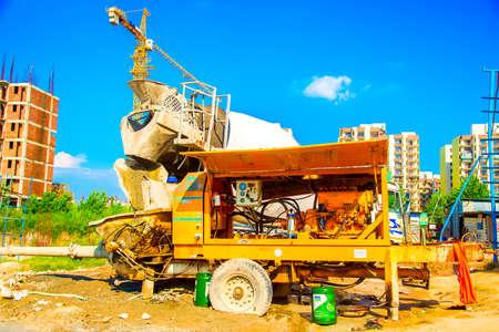 Delhi, India - October 2018: cement mixer working near the big constructions area in Delhi