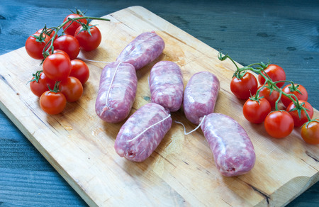 meats: Various fresh meats of chicken and pork with tomatoes