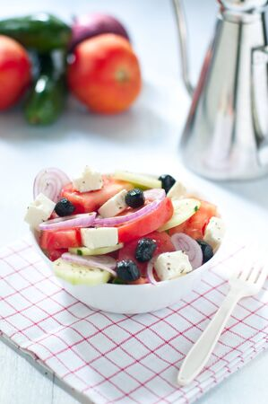 black olives: Greek salad with feta cheese tomatoes cucumbers and black olives