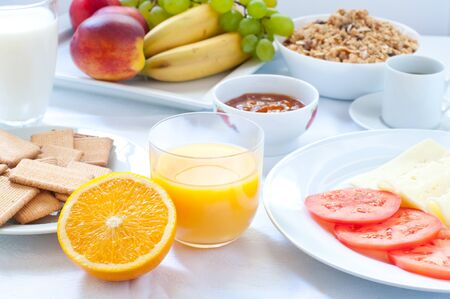 light breakfast: Continental breakfast with fruit , coffee , cheese , vegetables Stock Photo
