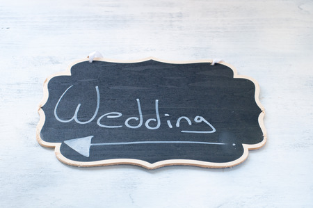 indicating: Sign indicating the marriage during a ceremony