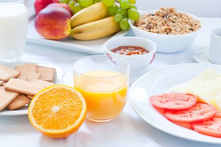 continental breakfast: Continental breakfast with fruit , coffee , cheese , vegetables Stock Photo