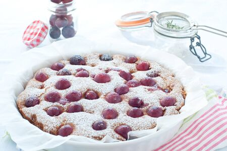 dessert table: Fresh cake with red grape season and icing sugar