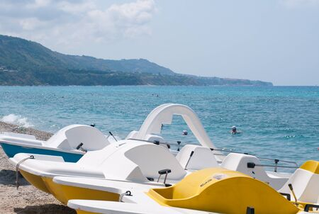 alcohol series: Series of boats with a slide on the beach waiting to sail