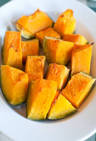 seasoned: Plate pumpkin roasted in the oven and seasoned with olive oil and salt