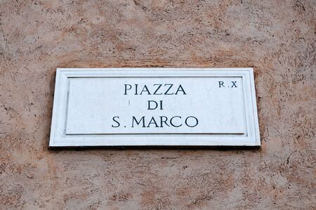 piazza san marco: Road sign indicating a street name in Italian Piazza San Marco in English means San Marco square, rome Stock Photo