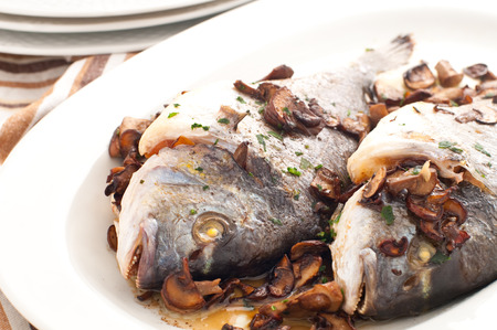 sea bream: Baked sea bream with mushrooms and parsley,italy