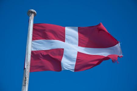 Flag of Malta against the blue sky