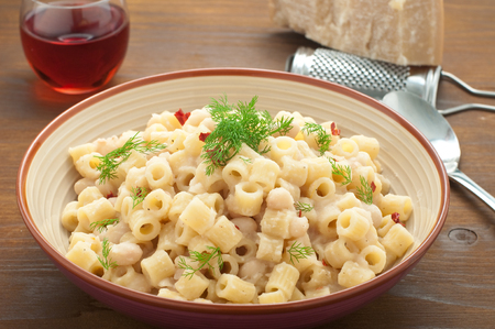 carots: Pasta and beans with bacon and wild Finocchieto, italy