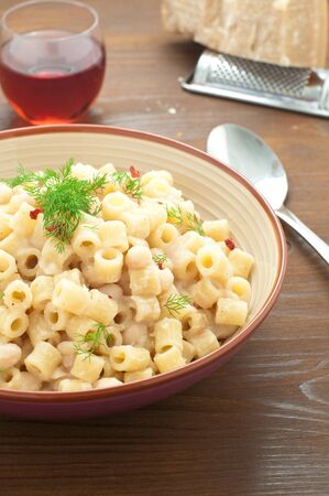 carot: Pasta and beans with bacon and wild Finocchieto, italy