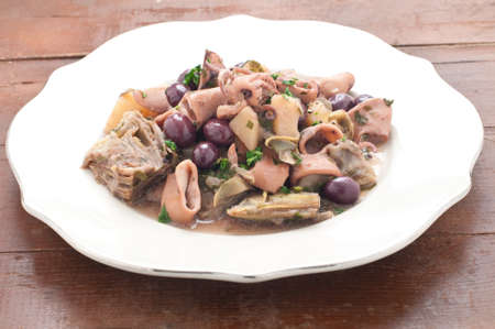 sanremo: Sanremo squid with potatoes, artichokes and olives taggia,italy Stock Photo