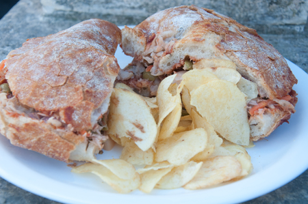 accompanied: Typical Maltese bread called ftira accompanied by french fries,malta