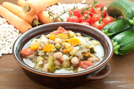 Vegetable soup, typical Italian soup with tomatoes, zucchini, potatoes and beans,italy