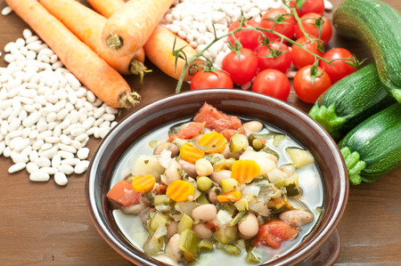 carots: Vegetable soup, typical Italian soup with tomatoes, zucchini, potatoes and beans,italy