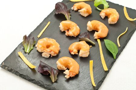 sanremo: prawns cooked in bisque with grapefruit sauce,italy Stock Photo