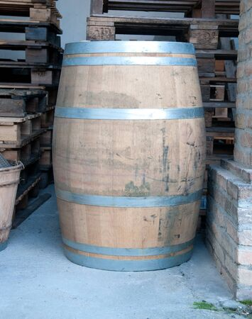 contain: Wooden barrels used to contain wine,italy