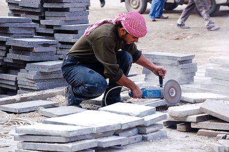 tree works: 12 february 2007-aleppo-sirya- bricklayer who works in marble in the city of Aleppo Editorial