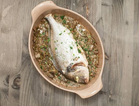 sanremo: Fish cooked bream baked with stewed artichokes,italy