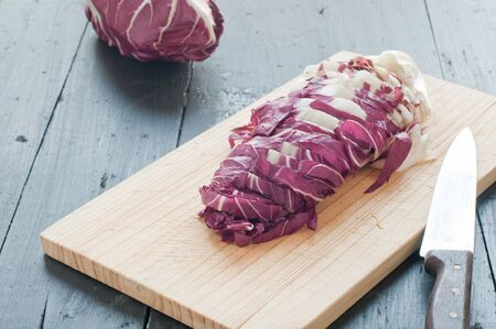 treviso: radicchio di Treviso red cut on a wooden cutting board,italy