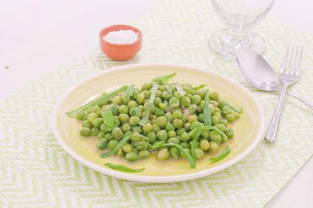 maccheroni: Fresh green peas stews seasoned with mint,italy Stock Photo