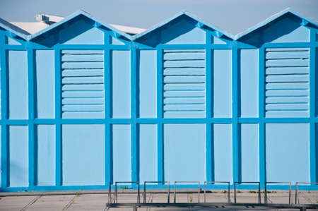 undressing: blue cabins on a beach that serve people for undressing