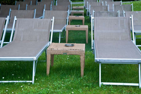small table: beautiful beach chairs with umbrella and small table