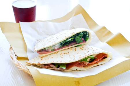 Cool and delicious piadine with ham , cheese and vegetables squaccherone,italy