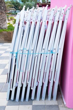 beach chairs: beautiful beach chairs waiting to be opened Stock Photo