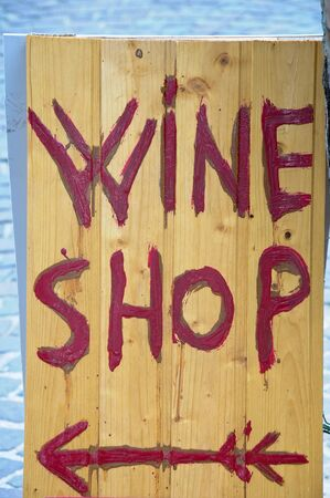 presence: wooden sign indicating the presence of a wine shop