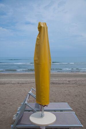 parasols: Closed parasols on the beach Sinigallia
