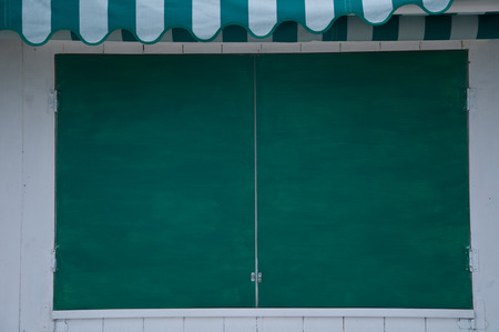 colored window: green colored window of a bar on the beach