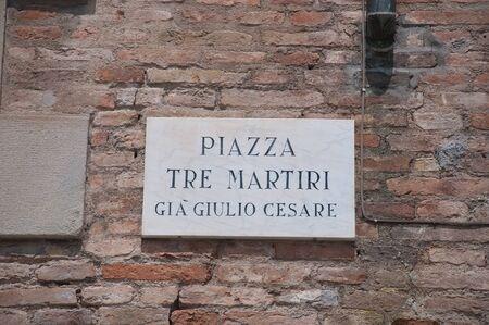 martiri: sign indicating the Tre Martiri square in rimini in the Emilia Romagna region,italy