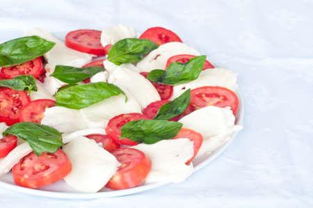 delicious and fresh caprese salad with mozzarella and tomato