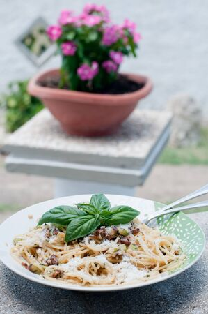 Cool and delicious pasta with lemon, arugula and pine nuts Stock Photo