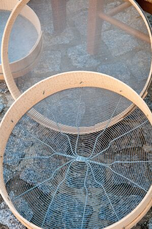sift: beautiful handmade sieves that are used to sift flour Stock Photo