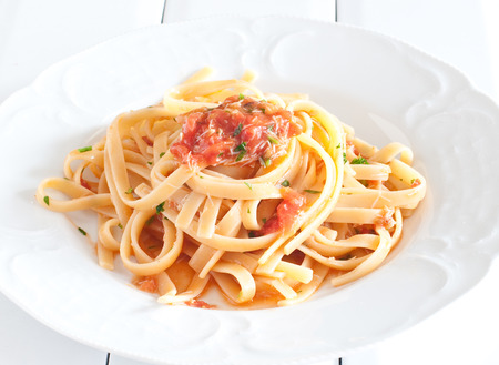 maccheroni: noodles with crab sauce and chopped tomatoes,food