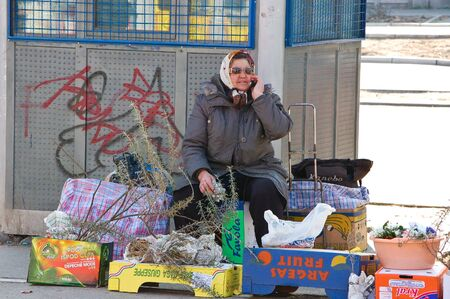 22 march 2009-novy sad-serbia-woman sell vegetables and fruit in the strret of   Novy Sad
