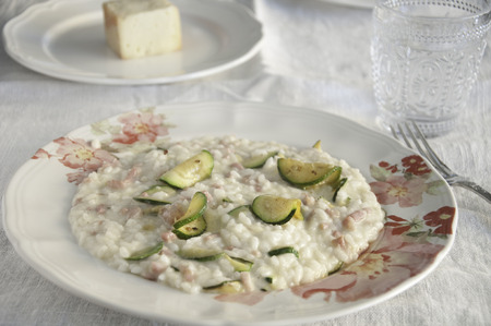 risotto with zucchini, pancetta and taleggio cheese,italy Standard-Bild