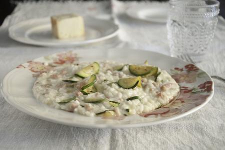 risotto with zucchini, pancetta and taleggio cheese,italy Foto de archivo