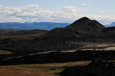 Icelandic landscapes with black volcanic soil 스톡 콘텐츠
