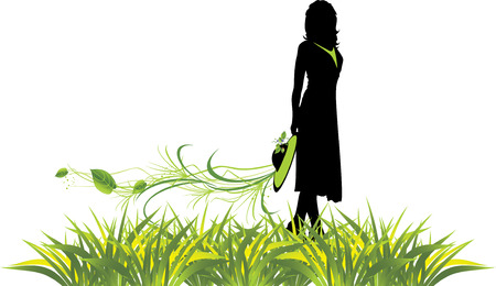 a sprig: Female silhouette with sprig among grass. Spring composition.