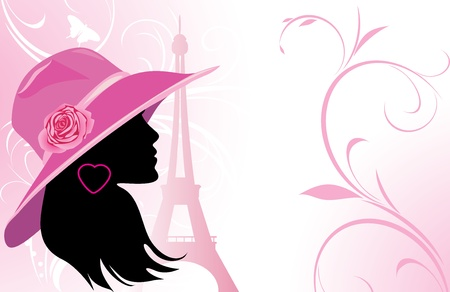 Elegant woman in a hat on the background of Eiffel tower