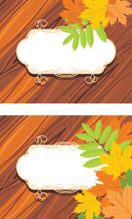 auburn: Decorative frames with maple leaves on the wooden background