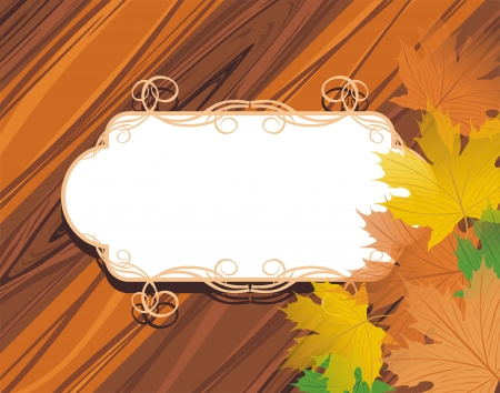 Decorative frame with maple leaves on the wooden background photo